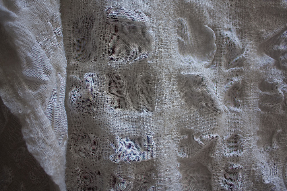 Plain weave with wool and cotton stripes, differential shrinkage