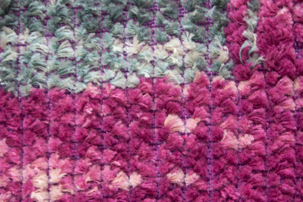 Corduroy weave in blue and fuchsia.