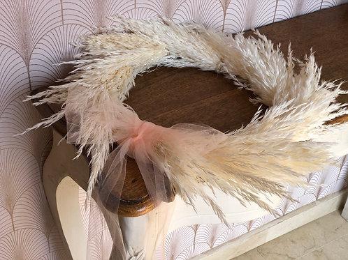Corona de plumero blanco