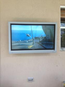 PATIO TV ON CONCRETE WALL - Copy