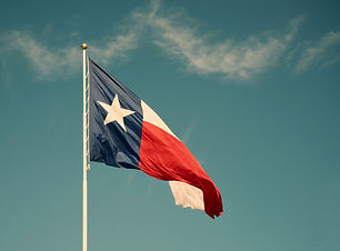 State flag of Texas against blue sky. Vi