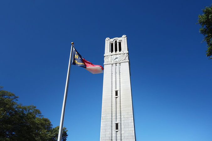 The bell tower and North Carolina state flag on the campus of NC State University .jpg