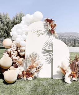 White Block Backdrop with Flower & Balloon Arrangement