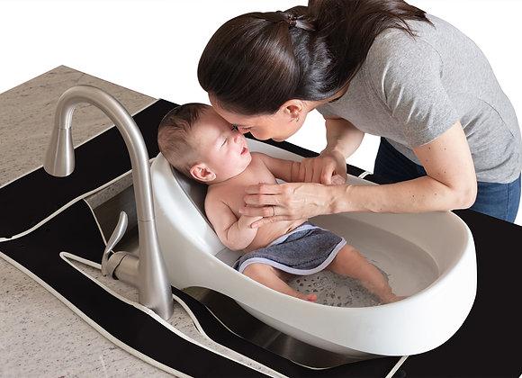 Baby taking sink bath with black kitchen SPLASHPAD sink mat