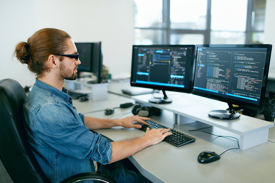 Programming. Man Working On Computer In
