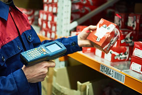 warehouse worker scanning automobile spa