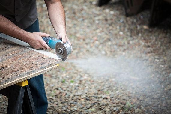 Man grinding stone slab