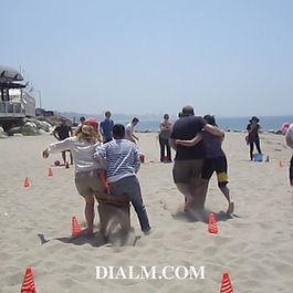 Corporate Team Building Beach Picnic GamesDial M Team building.jpg