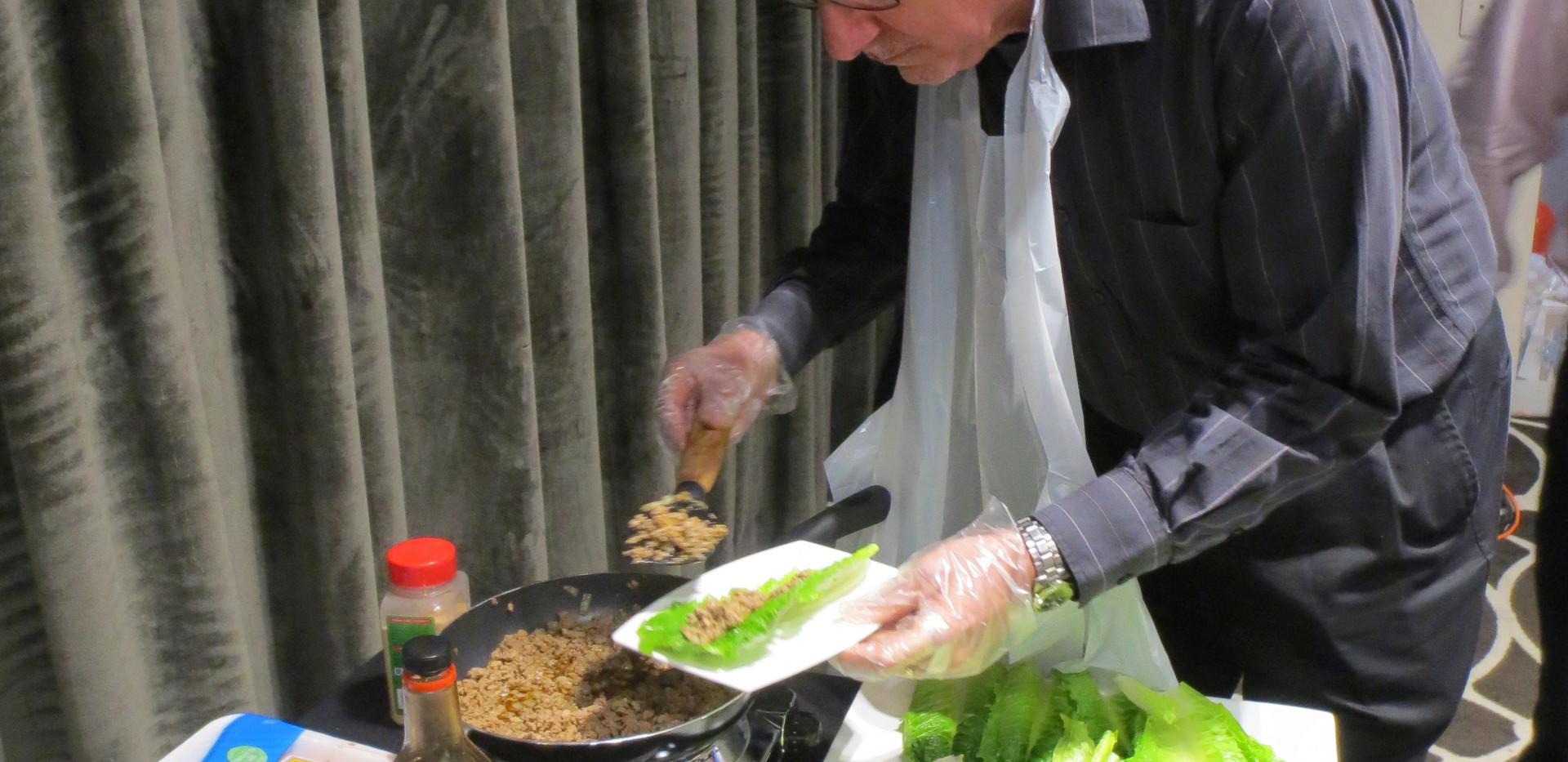 Hot plate cooking turkey lettuce wraps C