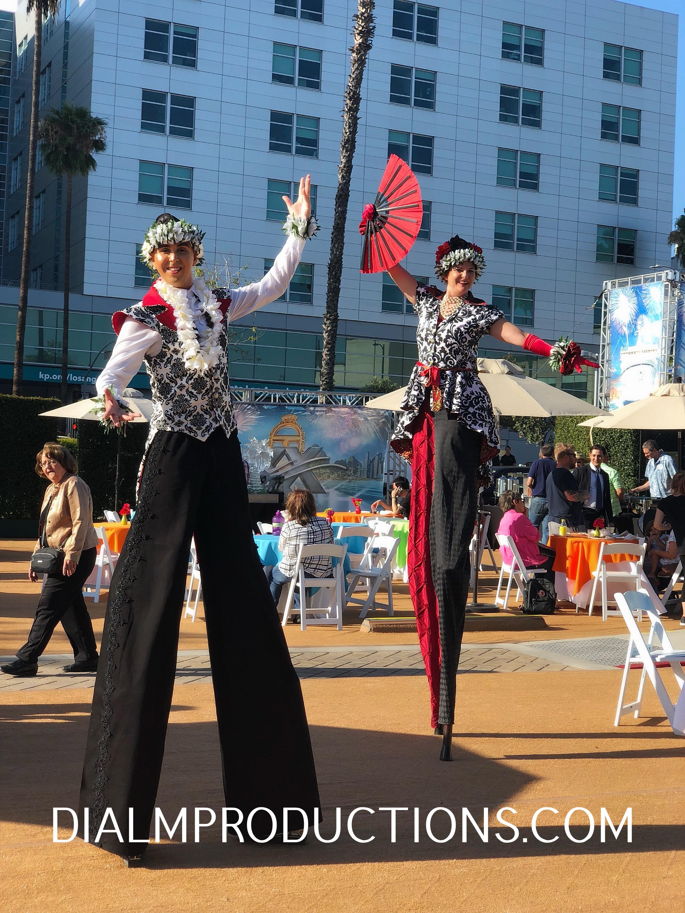 Black white red stilt walkers dialm