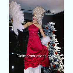 Red and White Stilt Walker with White Wig and Fan