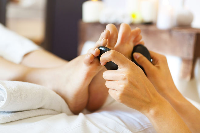 Massage of female foot in spa salon. Hea