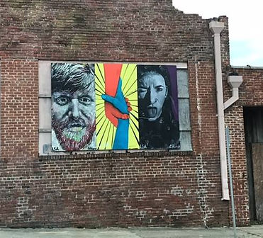 Longleaf student artwork installed on the Transfer Food Hall building during construction