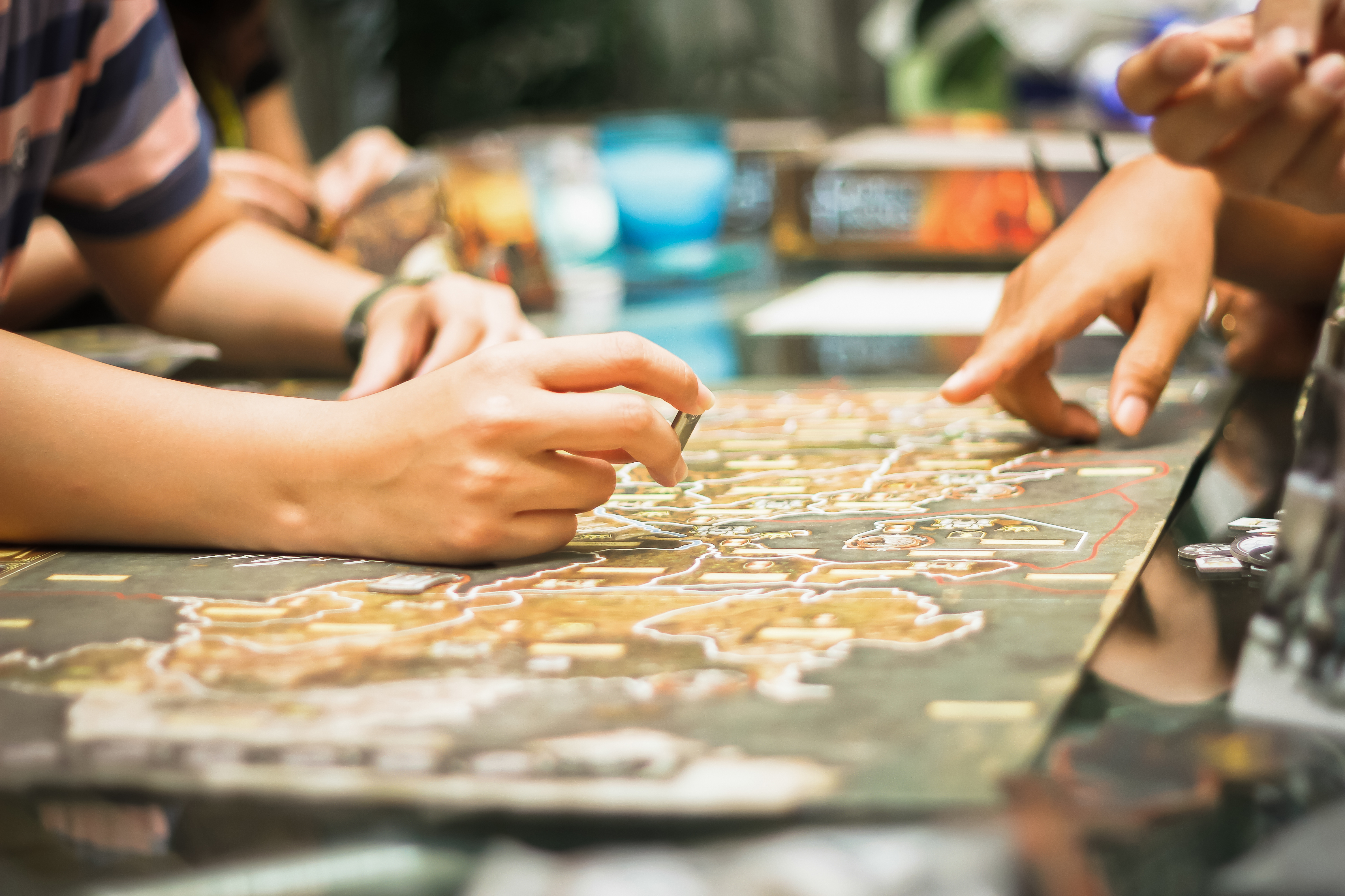 Hand playing board game, strategy concep
