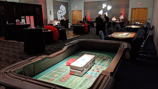 Three Card Tables, One Craps, One Roulette & Dealers