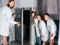 Group of surprised  adults wearing lab c