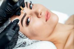 Professional cosmetologist hands are doi