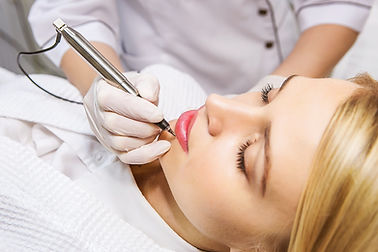 Cosmetologist applying permanent make-up