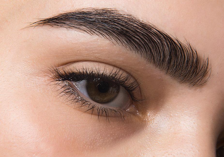 macro photo of a woman's eye, eyelashes