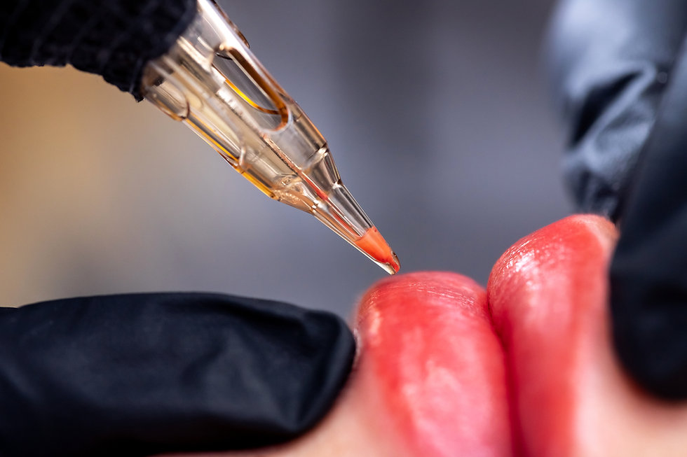 Macro photo of process of applying permanent makeup tattoo of red on lips woman..jpg