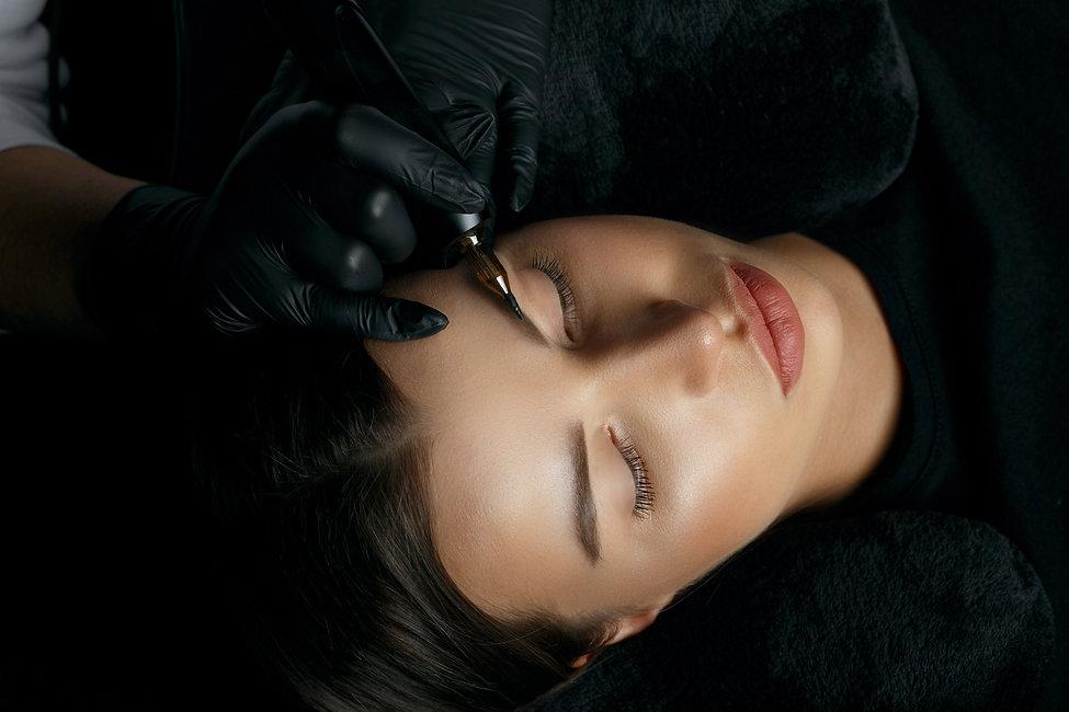 Young brunette woman having eyebrow perm