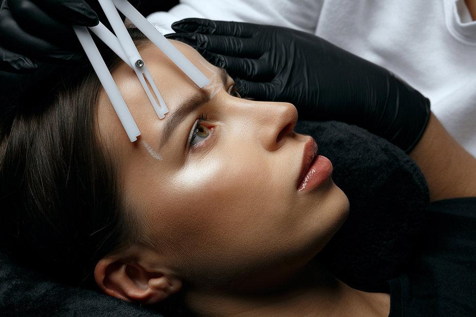 Woman in gloves making measuring of eyeb