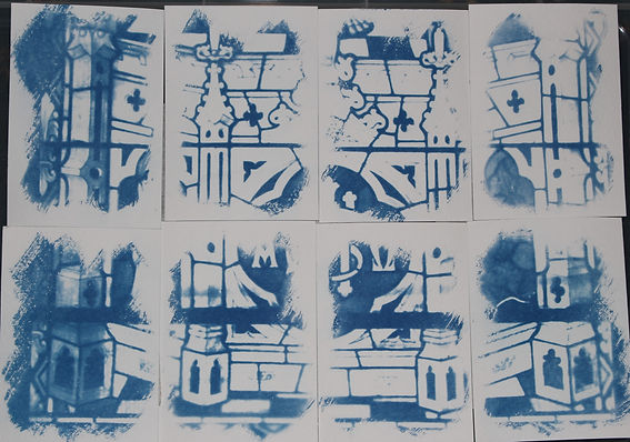 cyanotype cards of pieces of a stained glass window, in blue.