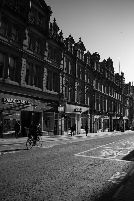 black and white street photograph of Grainger Street in Newcastle