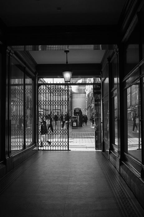 View from the entrance to the Central Arcade in Newcastle out onto Grainger street, in Black and white