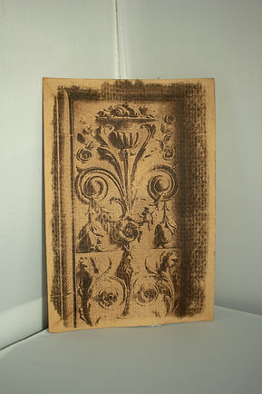 sepia toned small print card, floral carving from wall in central arcade newcastle