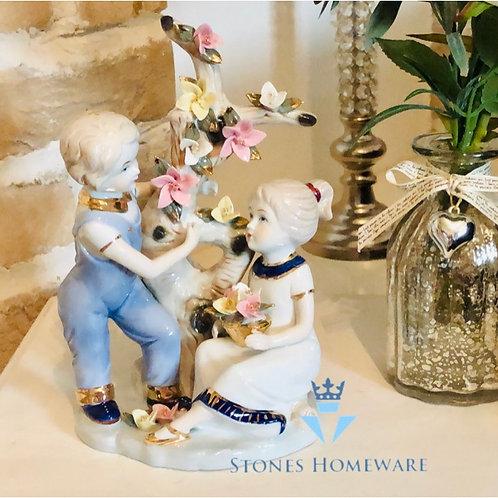 Girl and Boy Figurine
