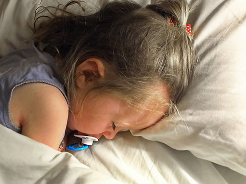 negative-space-toddler-asleep-cozy.jpg