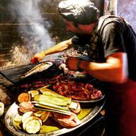 Grilling the local catch, Hvar, Croatia
