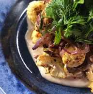 Spiced roasted cauliflower on preserved lemon labneh