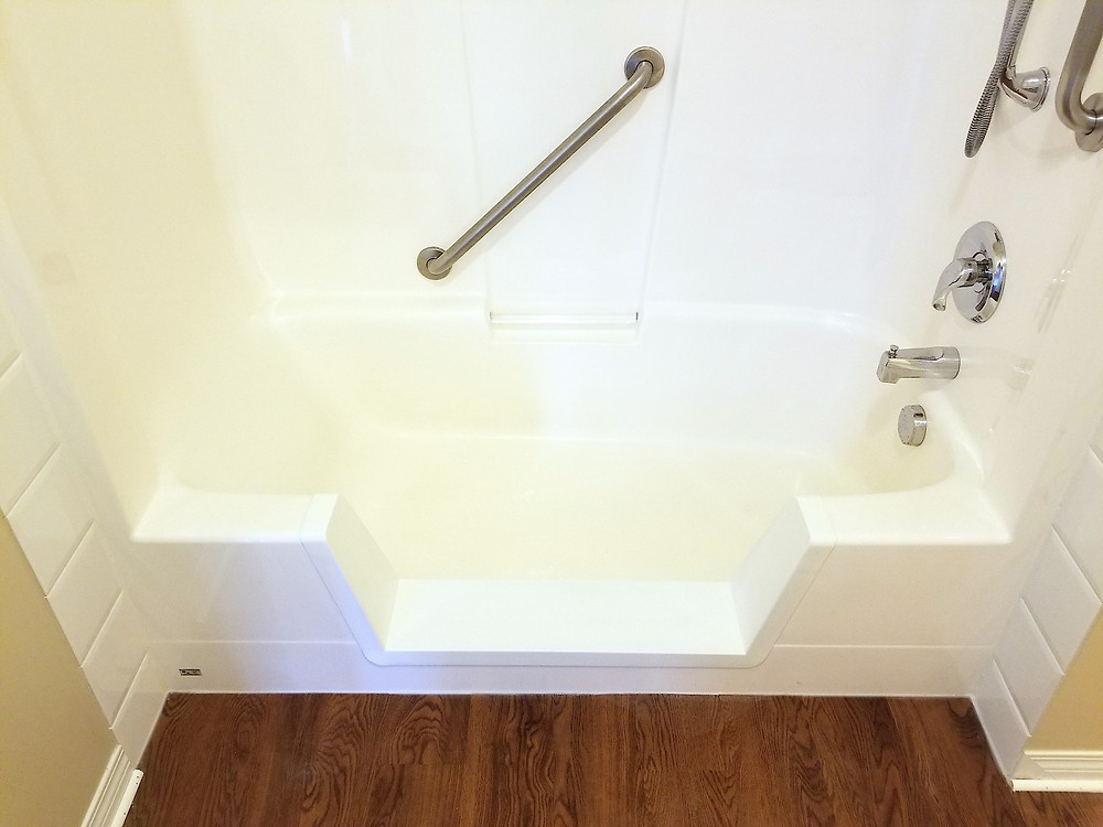 Walk-in shower with safety bar installed