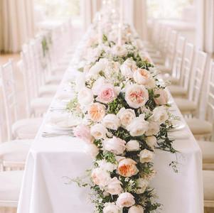 Long & Cascading floral table runner.