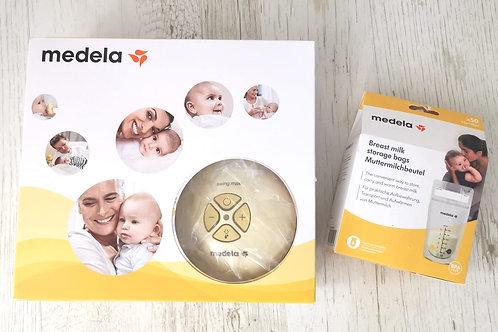 Medela Swing Maxi Electric (double pump) & 50 Medela breast milk storage bags