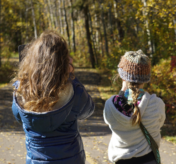 Two girls with cameras in nature