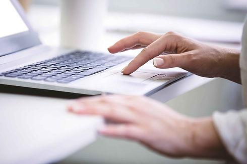 Pincus-Solutions-typing-on-laptop