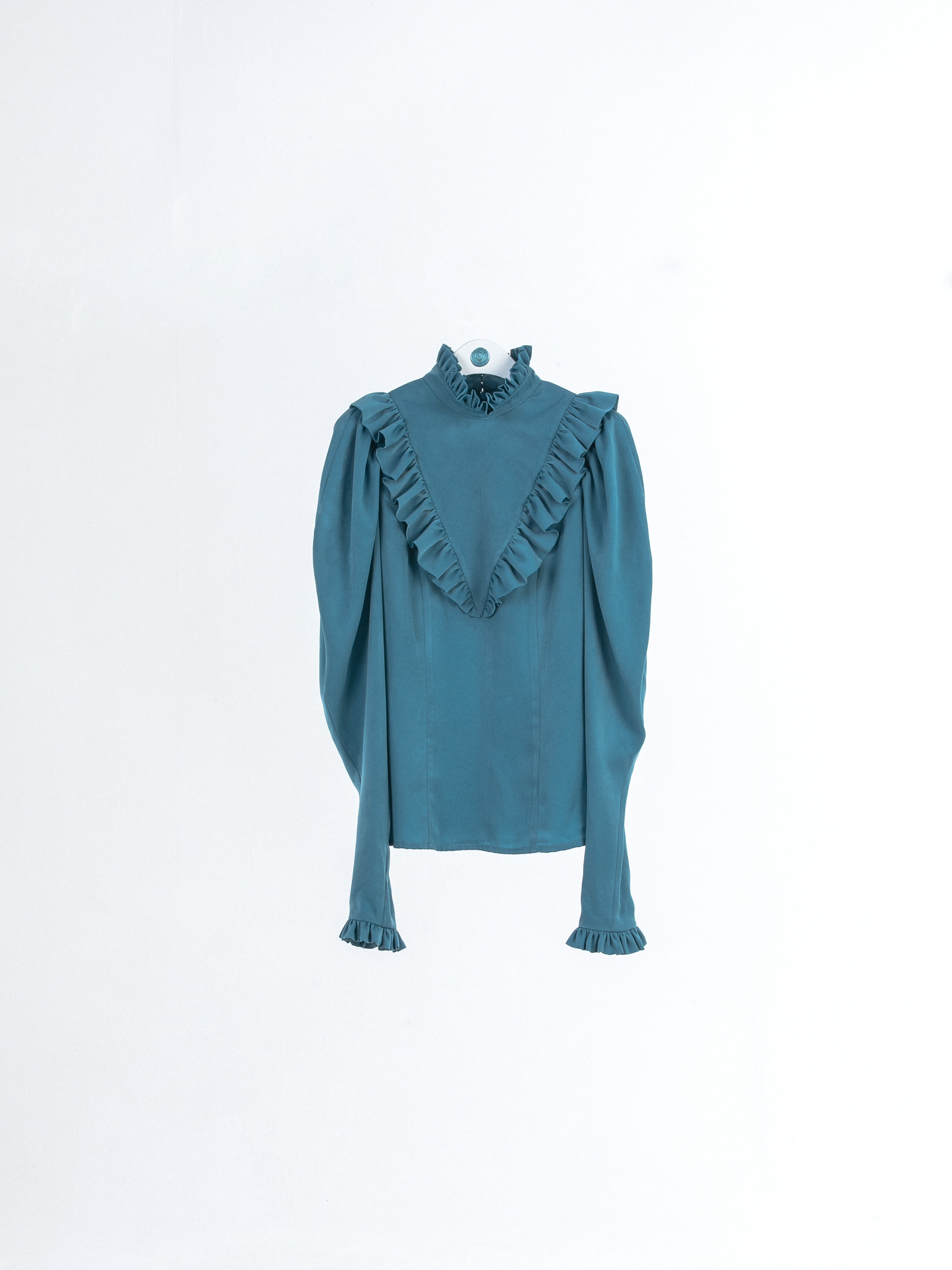 High neck blouse with ruffle detail