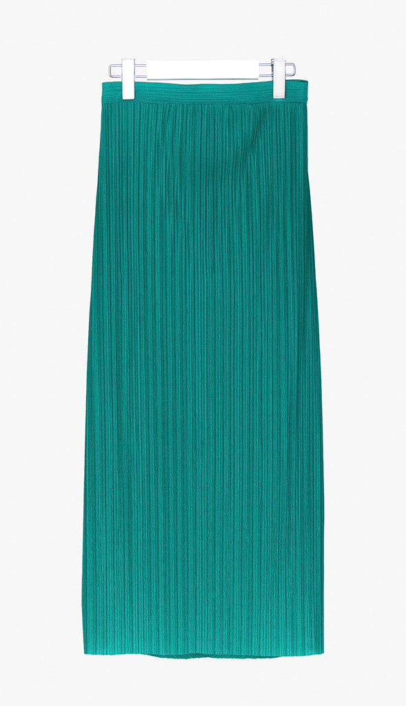 Form fitting pleated skirt with bias pleated detailing in the back