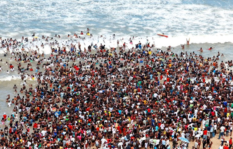 Throngs of people head to the beach to celebrate Christmas in South Africa