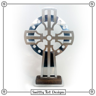 """Standing Cross The front piece is 1/8"""" brushed aluminum, the back piece is 1/8"""" polished aluminum, the base is 1/4"""" aluminum and the wood is a dark stained 1/4"""" thick oak assembled with a felt bottom. Overall it stands about 9.5"""" Tall, 6.5"""" Wide and 1.5"""" Deep"""