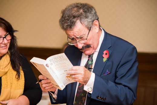 Lord Robert Winston about to autograph his book