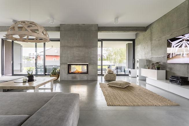 Spacious villa interior with cement wall