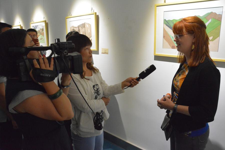 Interview of artist Amanda Porter at an art exhibit.