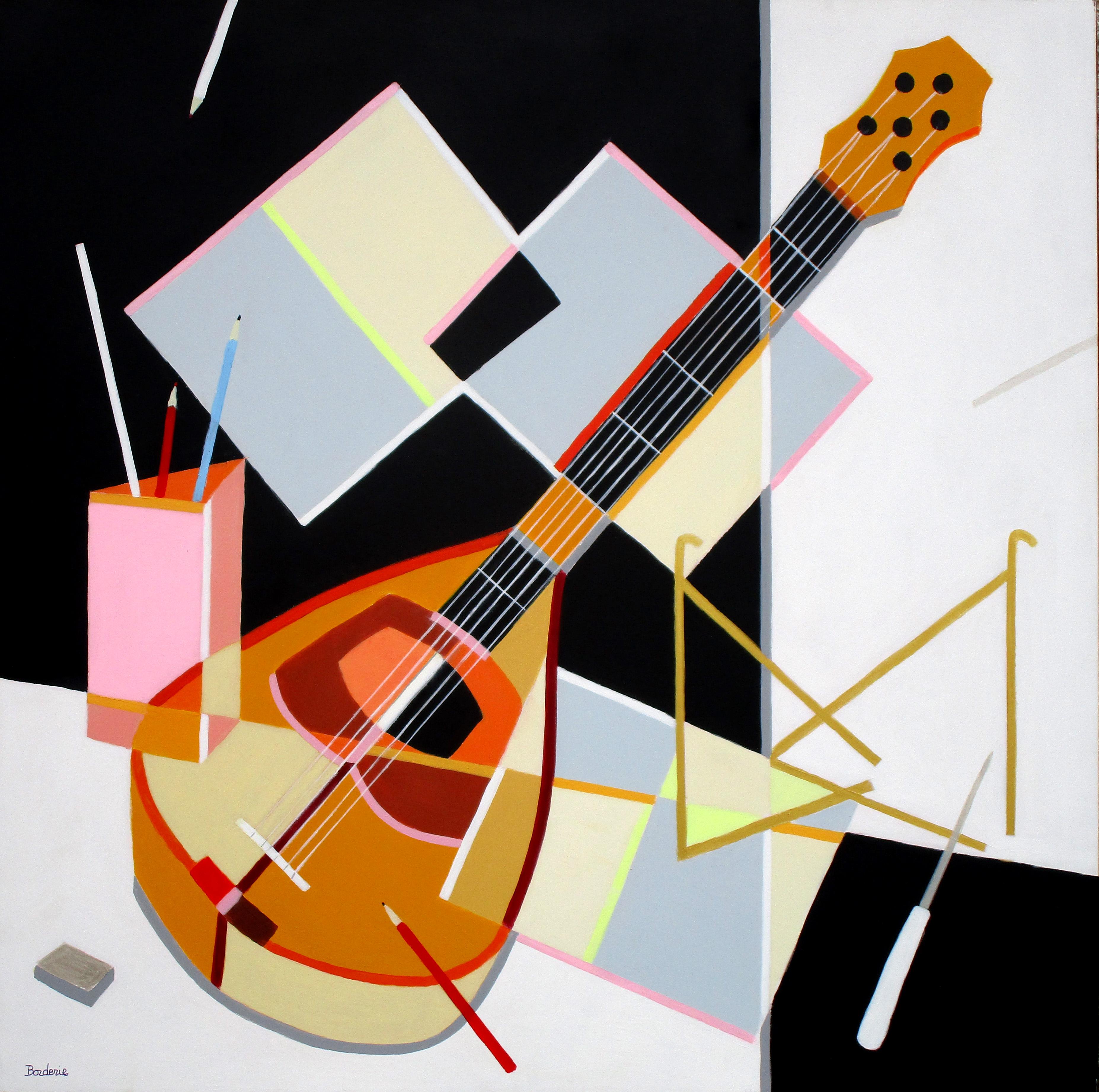 La mandoline et les crayons.