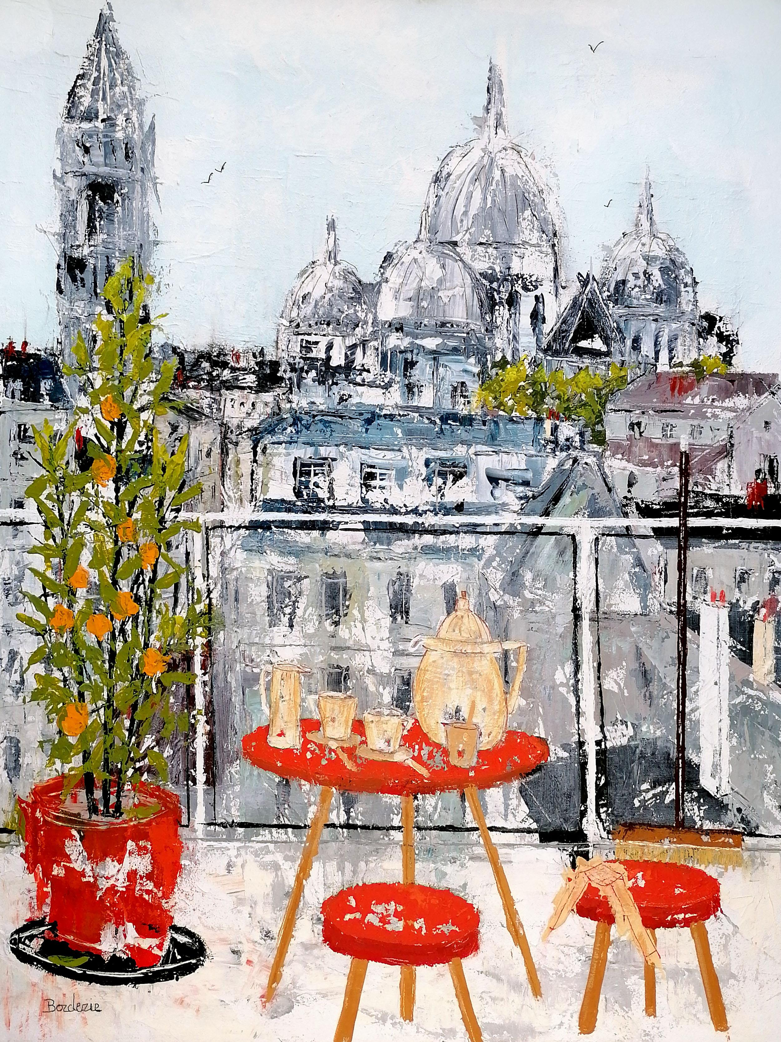 La_petite_terrasse_à_la_table_rouge_et_l