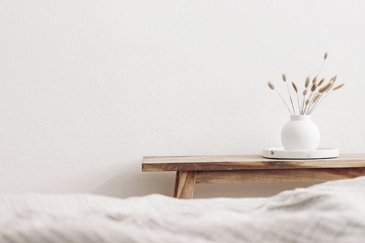 Modern white ceramic vase with dry Lagur