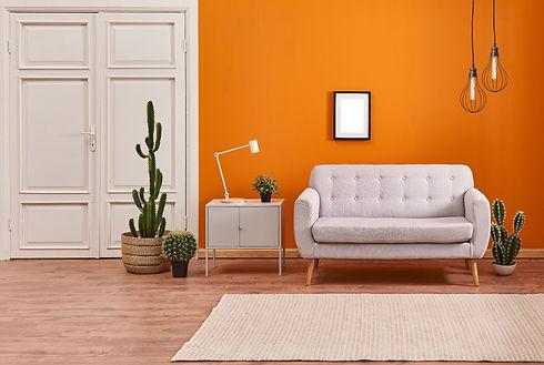 Orange%20wall%20and%20grey%20sofa%20with